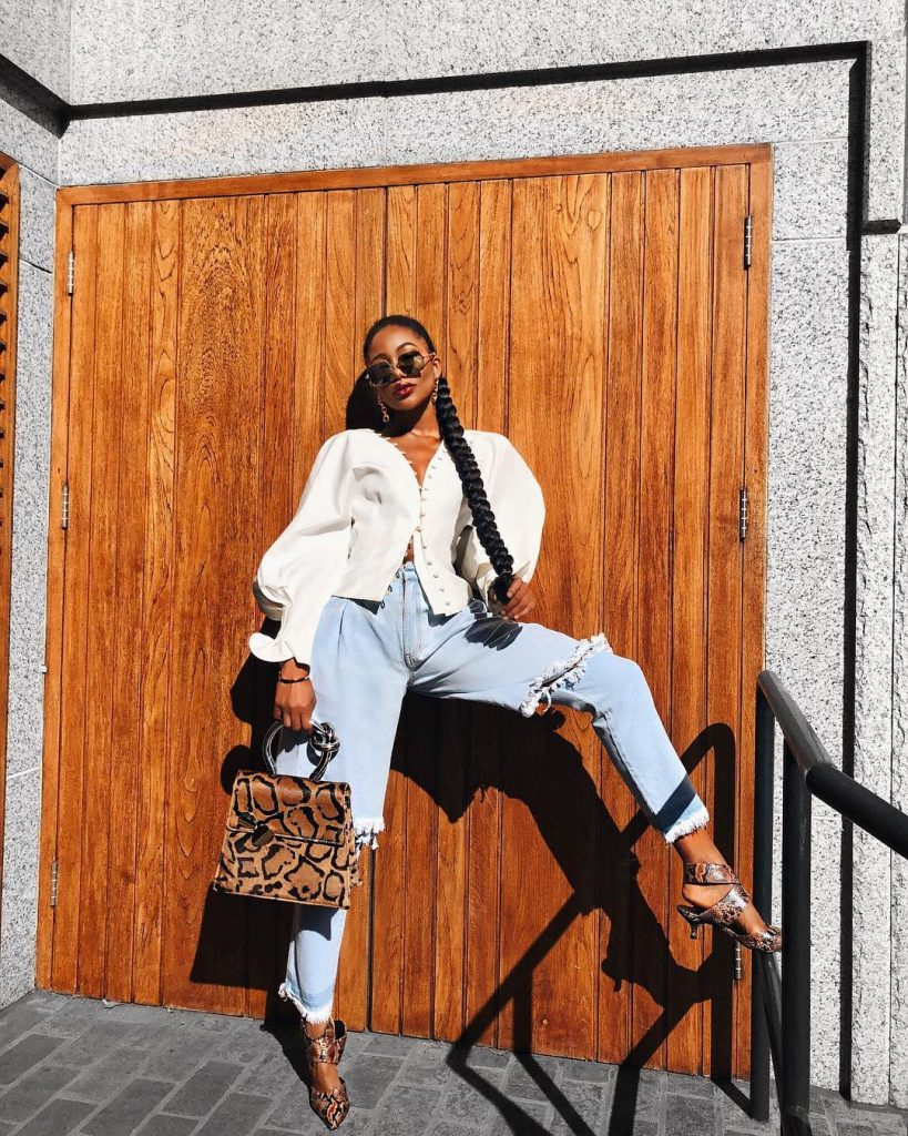 CLEVER WAYS TO LAYER SKIRTS OVER PANTS AND DRESSES LIKE THESE FASHION INFLUENCERS